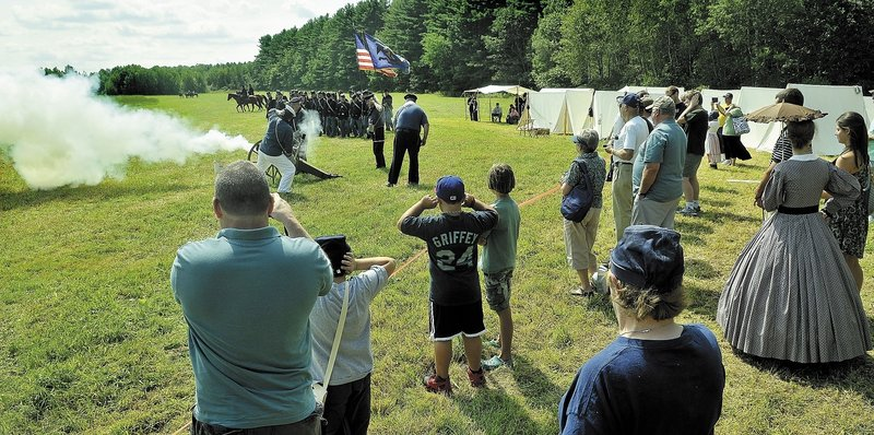 Union forces wait for a cannon shot before going into battle Saturday during a Civl War re-enactment at Good Will-Hinckley. Events, which are open to the public, continue Sunday from 9 a.m. to 2 p.m.