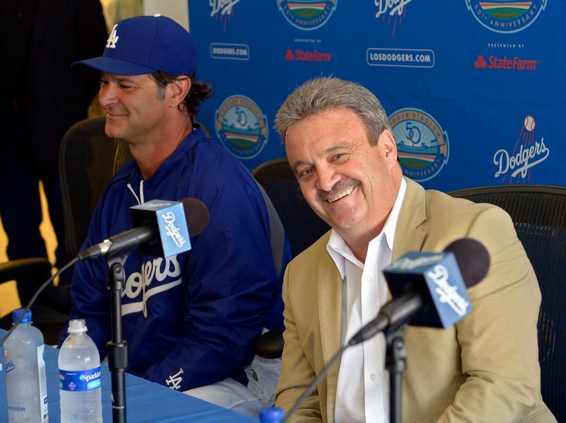 The Dodgers were all smiles after the trade Saturday, with General Manager Ned Colletti, right, and Manager Don Mattingly discussing what it meant to Los Angeles.