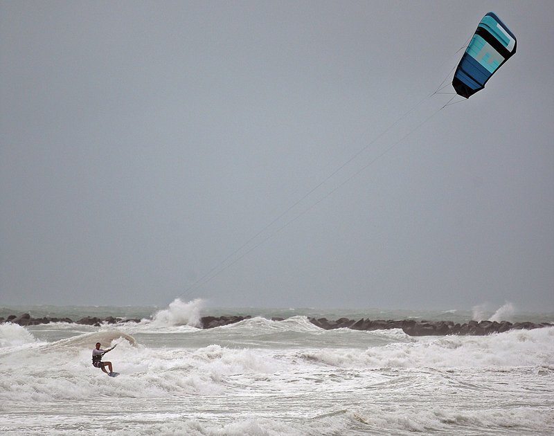 Folko Weltzien, 38, kite surfs as high winds from Tropical Storm Isaac gust Sunday in Miami. Forecasters say it could grow into a dangerous Category 2 hurricane.