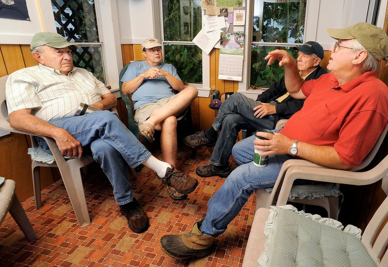 Wedgie Wheeler, right, makes a point as he discusses politics with his friends, from left, Chris Lutes, Alan Bradstreet and David Norman inside the cozy North Pownal Think Tank.