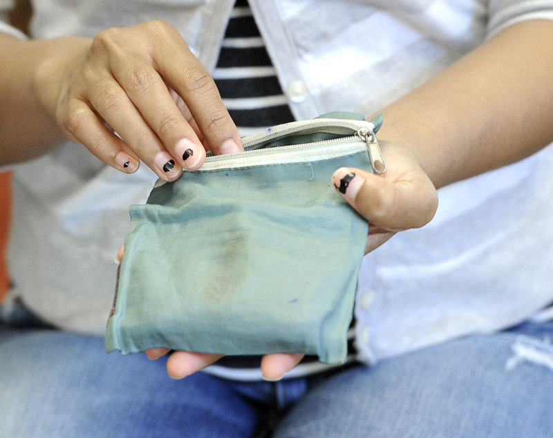 Ra Rim's purse that 8-year-old Abbie Jacobson found and returned contained more than $4,000.