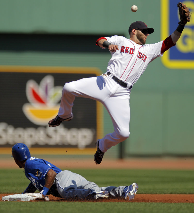 Dustin Pedroia can't catch a throw from Jarrod Saltalamacchia as Jarrod Dyson of the Royals steals second base in the first inning, setting up the only run allowed by Daisuke Matsuzaka in Boston's 5-1 win.