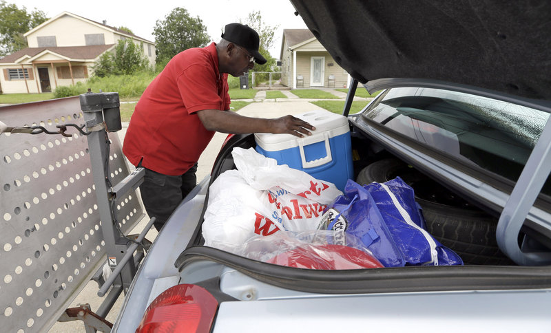 Charles Harris packs his car Monday as he prepares to evacuate his home in New Orleans' Lower Ninth Ward. Harris' home was destroyed by Hurricane Katrina seven years ago.