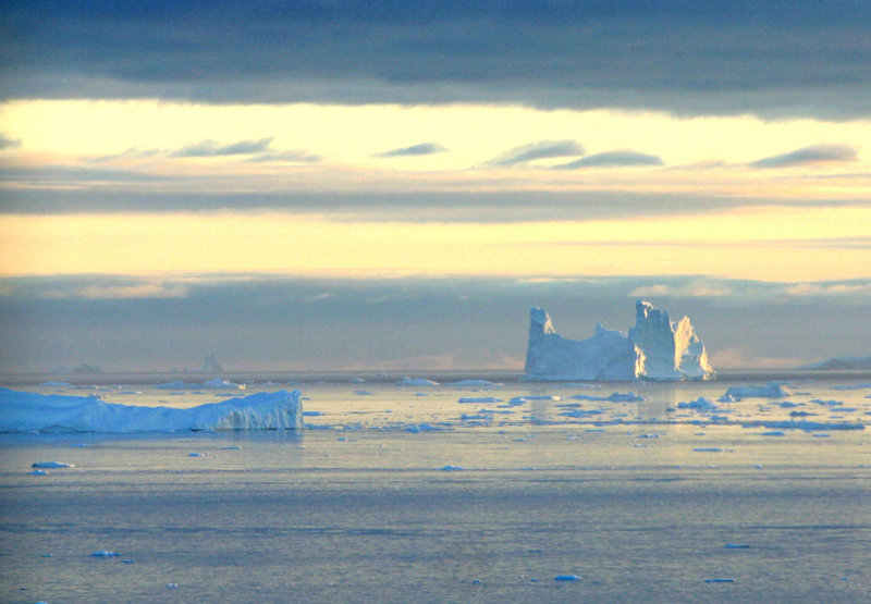 An iceberg is seen in Disko Bay, Greenland, above the Arctic Circle. Arctic sea ice reached a record low Monday.