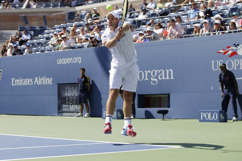 Andy Roddick returns a shot to fellow American Rhyne Williams, who was ranked 283rd, in the first round of play at the U.S. Open tennis tournament in New York on Tuesday.