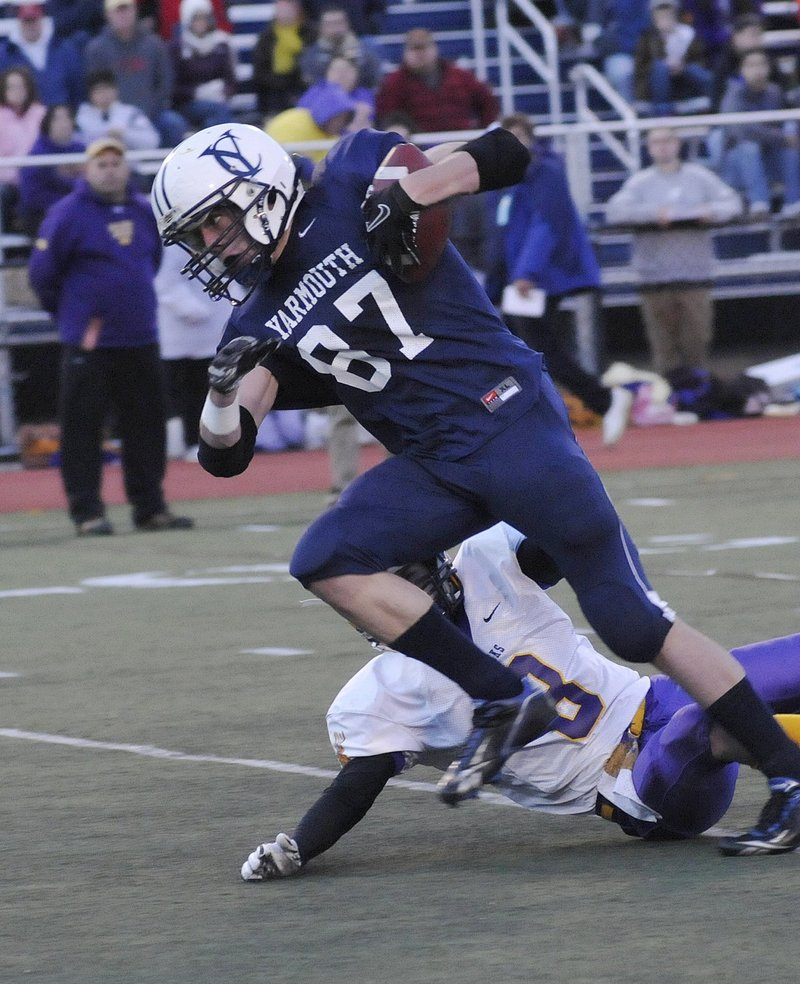 Nate Shields-Auble of Yarmouth comes up with big plays in big games, including this catch at tight end against Bucksport in the Class C state final last season, and hopes to lead his team to a third straight title.