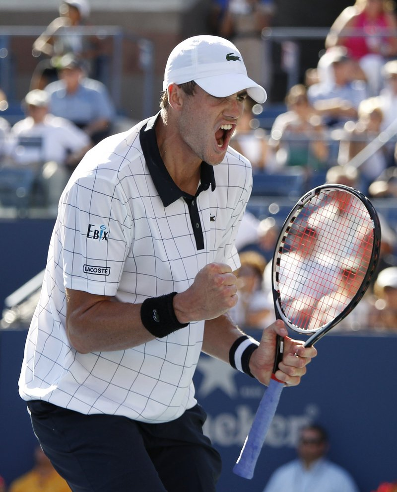 John Isner, at ninth the highest-ranked American man in the U.S. Open, got past Xavier Malisse in four sets in a first-round match Wednesday in New York.