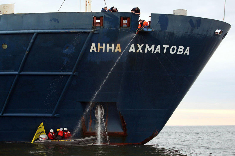 Greenpeace activists are chained Monday to the anchor chain of a ship carrying Gazprom workers to a drilling platform in the Pechora Sea. Gazprom is pioneering Russia's oil drilling in the Arctic, but activists say drilling could be disastrous.