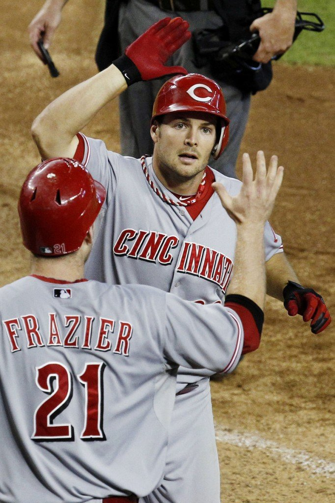 Chris Heisey of the Reds celebrates his two-run home run in the seventh inning Wednesday night. Heisey hit two homers in the 6-2 win over Arizona at Phoenix.