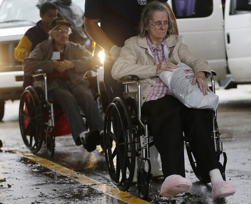 In Jesuit Bend, La., residents of the Riverbend Nursing Center are evacuated to higher ground as Isaac makes landfall Wednesday.