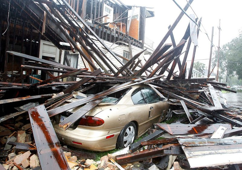 A house in New Orleans collapsed during the height of the storm, destroying three vehicles that were parked alongside.