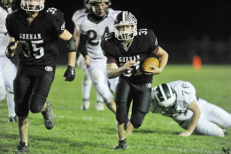 Matt McKenney of Gorham, carrying ball, may be hard to catch – he rushed for more than 1,000 yards a year ago – and the team will need it to spring upsets under new coach Jamal Chatman.