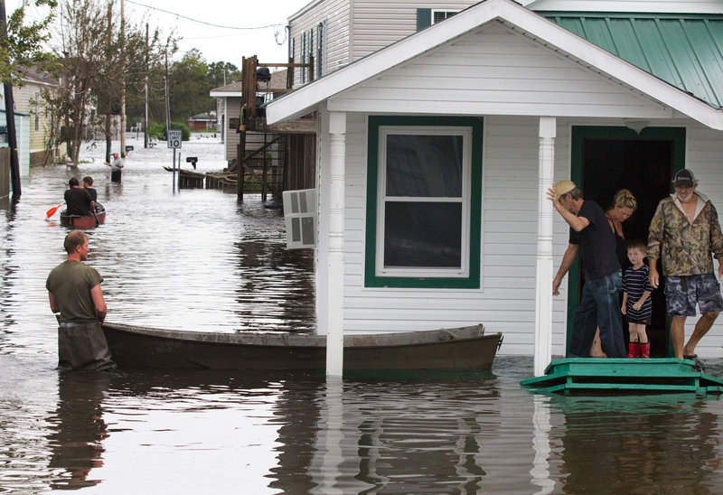 Flooding in Lafitte, La., causes residents to travel by boat Thursday, a day after Isaac hit the area near New Orleans.