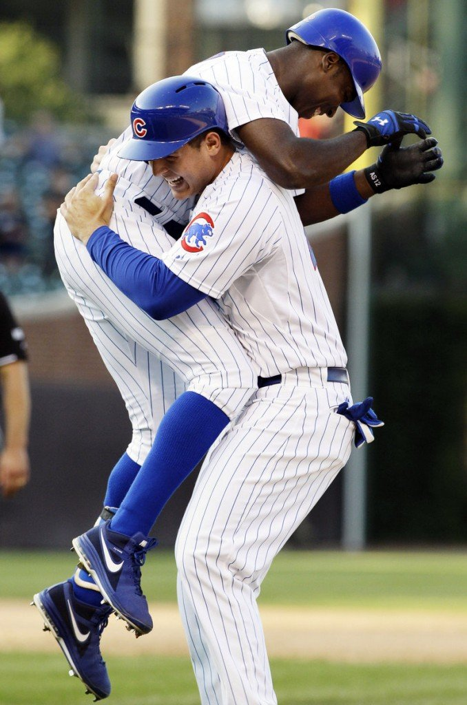 Alfonso Soriano of the Cubs, left, celebrates with Anthony Rizzo after Soriano singled home Starlin Castro in the bottom of the ninth to give Chicago a 12-11 win over the Milwaukee Brewers.