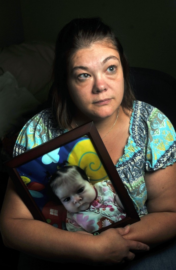 Nicole Greenaway holds a picture of her daughter Brooklyn Foss-Greenaway at her home in Clinton. Her 3-month-old baby died while in the care of Amanda Huard on July 8.