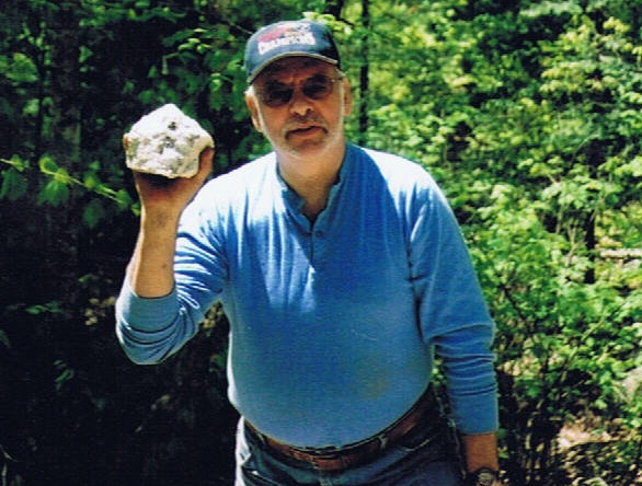 Kennebec Rocks & Minerals Club member Ron LePage poses with a softball-sized chunk of amethyst he discovered several years ago on a rock dig.