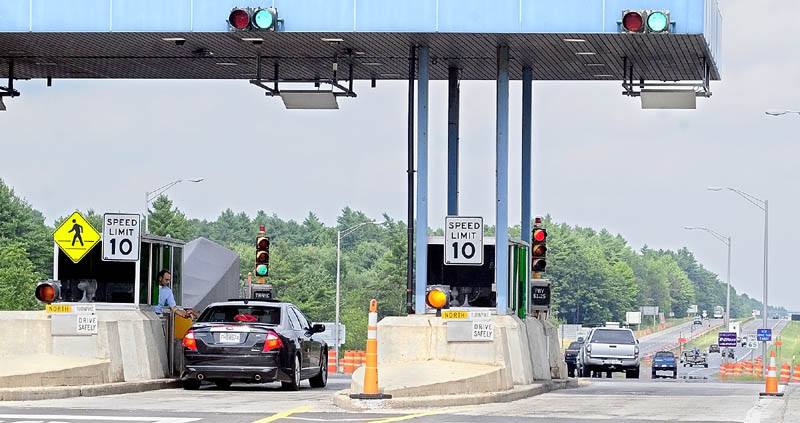 Vehicles go through the Mile 101 toll plaza on the Maine Turnpike (Interstate 95) on Thursday in West Gardiner. Under a toll increase proposal tentatively adopted by Maine Turnpike Authority's board Thursday the toll there would go up 50 cents from $1.25 to $1.75.