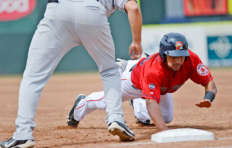 Portland's Ryan Dent dives back to first base, avoiding a pickoff against the New Britain Rock Cats Sunday at Hadlock Field.