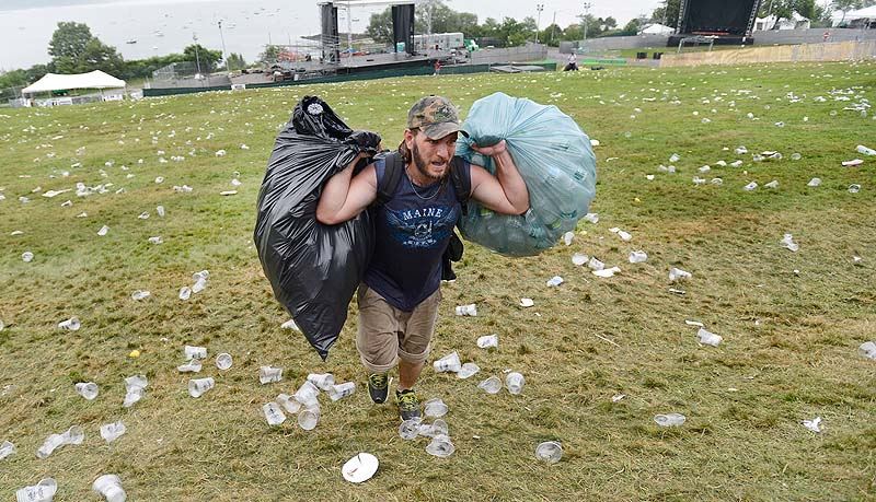 James Baldwin of Portland carries bags of returnables up the hill on the Eastern Prom last spring.