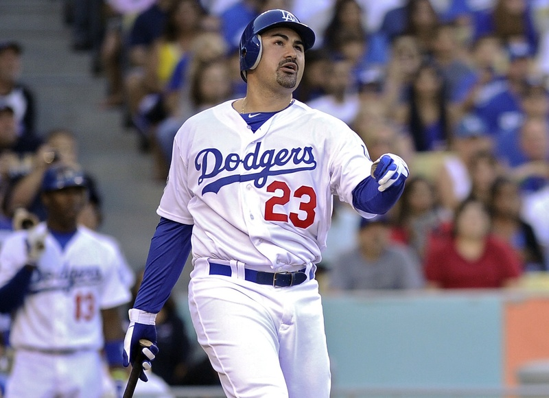 A familiar face in a new uniform got off to a can't-top-this start Saturday night. Adrian Gonzalez of the, yes, Los Angeles Dodgers, hit a three-run homer in his first at-bat with his new team, right after stepping off a cross-country flight.