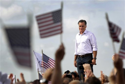 FILE - In this Aug. 31, 2012, file photo Republican presidential candidate, former Massachusetts Gov. Mitt Romney appears on stage during a campaign event at Lakeland Linder Regional Airport in Lakeland, Fla. Romney and President Barack Obama have made the election not just about the economy, or even the American Dream, but America itself. They see a nation pessimistic about itself and nervous about its future, and a political opportunity in the anxiety to come through as the one who gets what it means be American, and restore the glory. (AP Photo/Mary Altaffer, File)