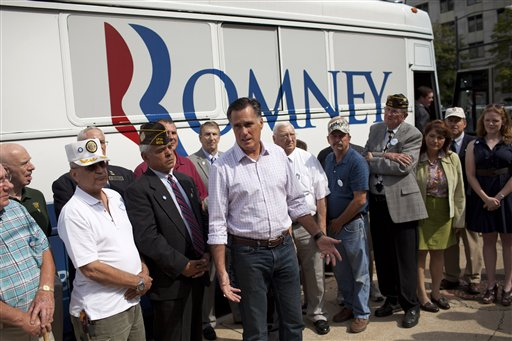 """Republican presidential candidate, former Massachusetts Gov. Mitt Romney speaks with the news media after making a stop at the """"New Hampshire Veterans and Military Families for Mitt"""" event, Thursday, Sept. 6, 2012, in Concord, N.H. (AP Photo/Evan Vucci)"""