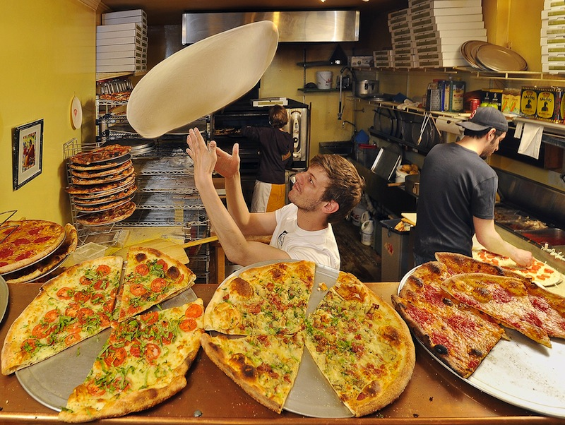 In this May 2011 file photo, Travis Curran of Otto Pizza tosses pizza pies as Nick Belkas adds the special eclectic toppings that attracted the attention of the Food Network. Otto is one of many restaurants that failed a recent health inspection by Portland, but it passed its follow-up inspection, unlike many others.