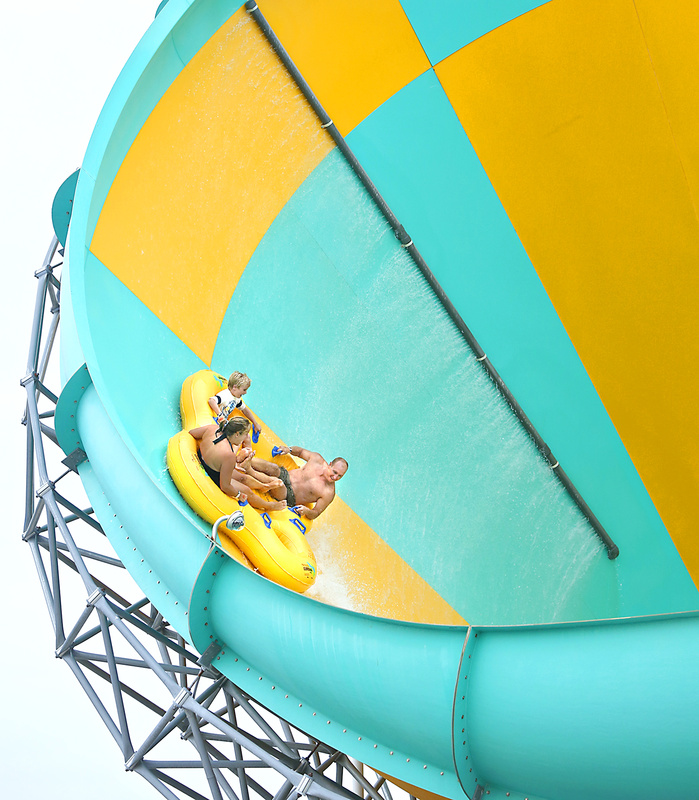 Peter Greene, his son Harry, 8, of Portland, and their friend Christine Byrne of Cumberland ride the Tornado on Friday at Funtown Splashtown USA, which saw an increase in tourists from Canada and southern New England this summer.