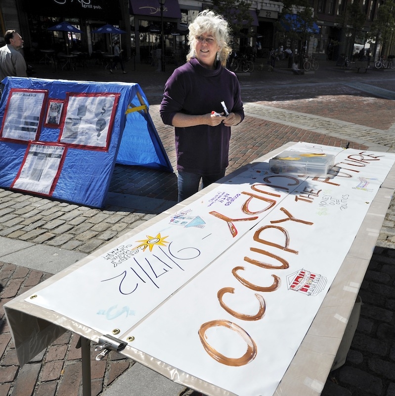 Nora Tryon of Kennebunkport discusses her roll in the girst anniversary of Occupy movement as she sets up in Monument Square on Monday, Sept. 17, 2012.