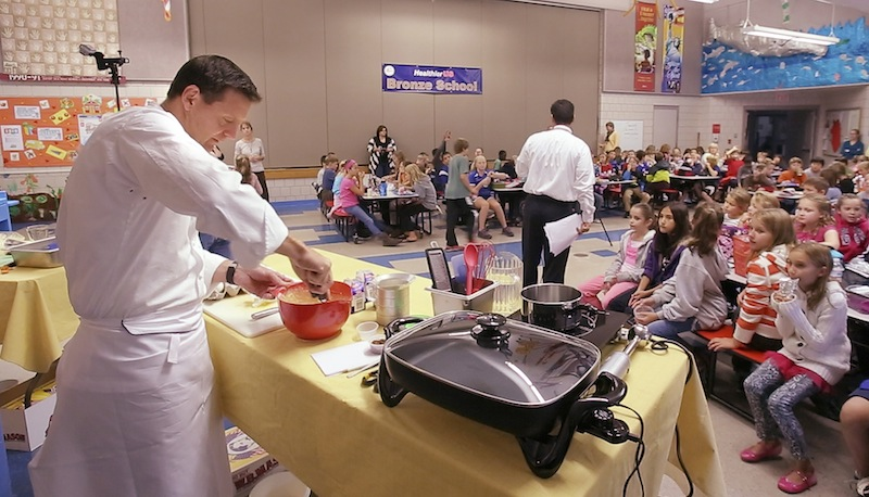Jonathan Cartwright, executive chef at the White Barn Inn, competes in an Iron Chef-type competition at Sea Road School in Kennebunk on Friday, September 28, 2012 with Ellen Demmons, the food services director for RSU 21. The secret ingredient announced at the start of the competition was sweet potatoes and the school's fourth graders from the school were the judges of the chefs' final creations.