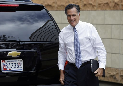 Republican presidential candidate Mitt Romney arrives at his campaign headquarters in Boston, to prepare for the presidential debates on Sunday.