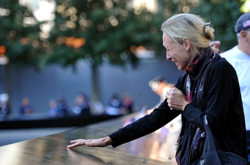 Carrie Bergonia remembers her fiancee, firefighter Joseph Ogren, who was killed in the terrorist attacks of Sept. 11, 2001, during a ceremony marking the 11th anniversary of the attacks at the National September 11 Memorial at the World Trade Center site in New York, Tuesday, Sept. 11, 2012. (AP Photo/The Daily News, Todd Maisel, Pool)