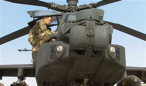 In this image from video, Britain's Prince Harry inspects an Apache helicopter at Camp Bastion in Afghanistan on Friday. Prince Harry will be based at Camp Bastion during his tour of duty as a co-pilot gunner.