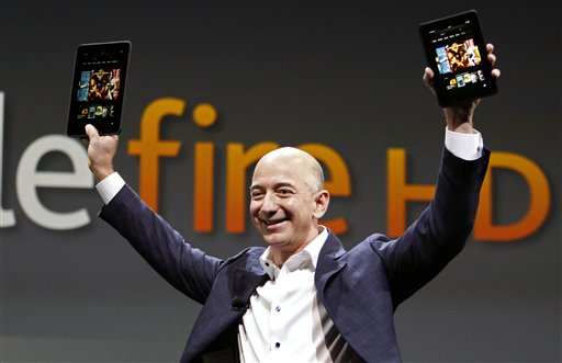 Jeff Bezos, CEO and founder of Amazon, holds the new Kindle Fire HDs in Santa Monica, Calif., on Thursday.