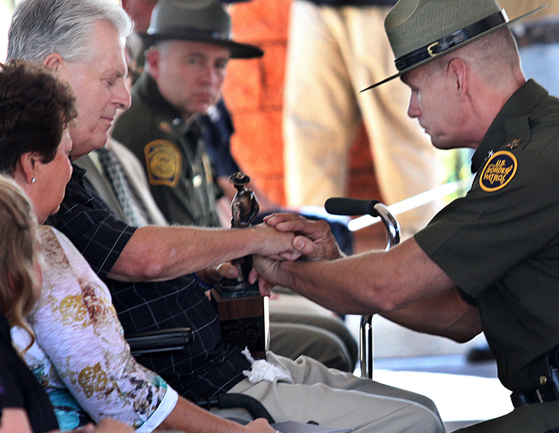 "Kent Terry Sr., father of Border Patrol Agent Brian Terry, and Richard ""Rick"" Barlow, chief patrol agent of the Tucson sector, share a quiet moment during the dedication ceremony for a new station named after Brian Terry on Tuesday in Naco, Ariz. Brian Terry was killed in a December 2010 firefight with bandits north of the Mexican border. Two guns found at the scene were bought by a member of a gun smuggling ring that was being monitored in the government's botched gun smuggling probe known as Operation Fast and Furious."