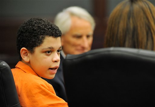Cristian Fernandez, 13, left, talks with his attorneys in Judge Mallory Cooper's courtroom in Jacksonville, Fla., on Aug. 7. The case of Fernandez, who is charged with murdering his 2-year-old half brother and sexually abusing another young half sibling, is scheduled to be heard before Cooper on Sept. 28.