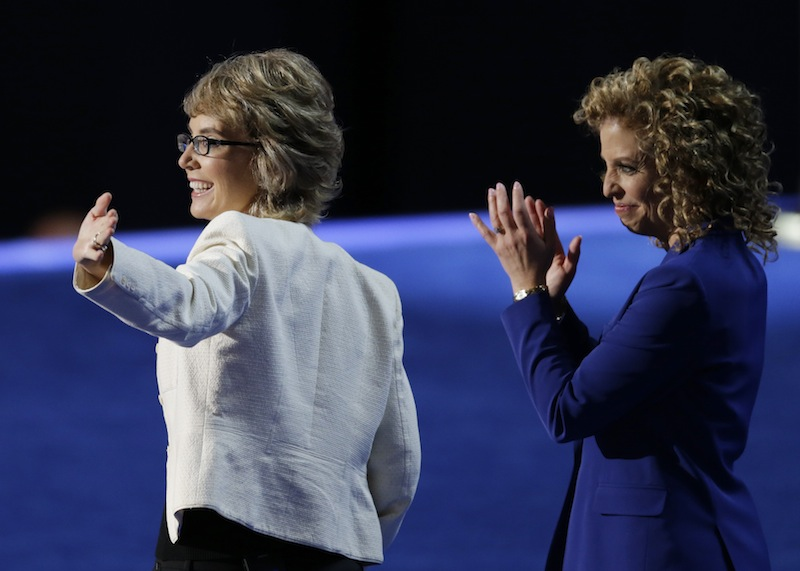 Former Rep. Gabrielle Giffords, left, walks with Democratic National Committee Chairwoman Rep. Debbie Wasserman Schultz, from Florida, to recite the Pledge of Allegiance the Democratic National Convention in Charlotte, N.C., on Thursday, Sept. 6, 2012. (AP Photo/Lynne Sladky)