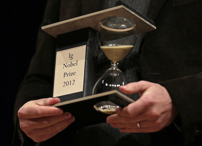 A 2012 Ig Nobel Prize trophy is held during a performance at the Ig Nobel Prize ceremony at Harvard University, in Cambridge, Mass., Thursday, Sept. 20, 2012. The Ig Nobel prize is an award handed out by the Annals of Improbable Research magazine for silly sounding scientific discoveries that often have surprisingly practical applications. (AP Photo/Charles Krupa)