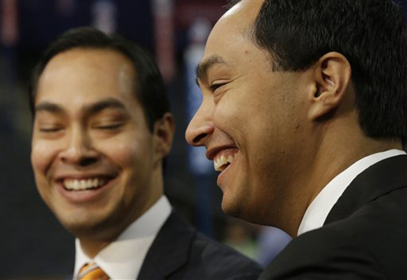 San Antonio Mayor Julian Castro, left, who will be the convention keynote speaker, and his twin brother, State Representative Joaquin Castro, who is running for U.S. Congress, are interviewed at the Democratic National Convention in Charlotte, N.C., Monday, Sept. 3, 2012. (AP Photo/Charles Dharapak)