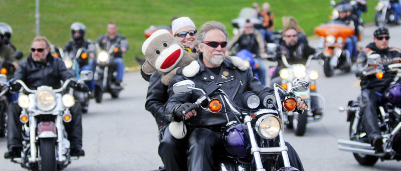 Motorcyclists roll out of the Augusta Civic Center at noon on Sunday at the commencement of the annual United Bikers of Maine Toy Run. Augusta police estimated a couple thousand bikes road from the ACC to the Windsor Fairgrounds to donate toys.