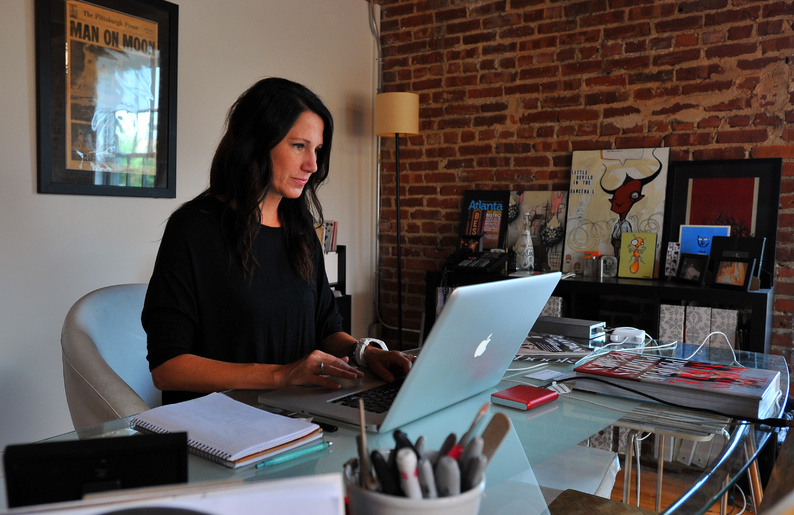"""Caren West works at her office in Atlanta in July. Like many others, she finds it hard to break away from work while on vacation. """"It almost doesn't make sense to go on vacation, because not only are you working, but you come back to twice as much work,"""" said West, co-owner of Caren West Public Relations. """"I always feel guilty about not working."""" 08000000 10000000 HUM krtfeatures features krthumaninterest human interest krtlifestyle lifestyle krtnational national leisure LIF krtedonly mct 08002000 curiosity ODD 10005000 10007000 FEA holiday krttravel travel LEI vacation 2012 krt2012"""