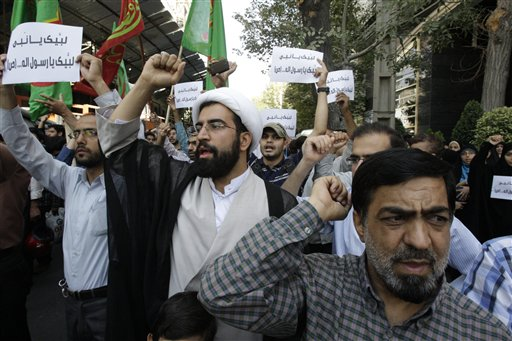 Iranian protestors chant slogans during a demonstration against a film ridiculing Islam's Prophet Muhammad, in front of Swiss Embassy in Tehran, which represents US interests in Iran on Thursday. The Associated Press photo