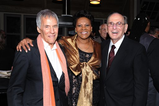 """Legendary songwriters Bert Bacharach, left, and Hal David join singer Dionne Warwick on Oct. 17, 2011, at the """"Love, Sweet Love"""" musical tribute to David in Los Angeles. David, who, along with Bacharach, penned dozens of top 40 hits for a variety of recording artists in the 1960s and beyond, died Saturday in Los Angeles."""