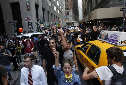 Occupy protesters fill an intersection on Monday in New York. A handful of other Occupy protesters was arrested during a march on the New York Stock Exchange on the anniversary of the grass-roots movement.