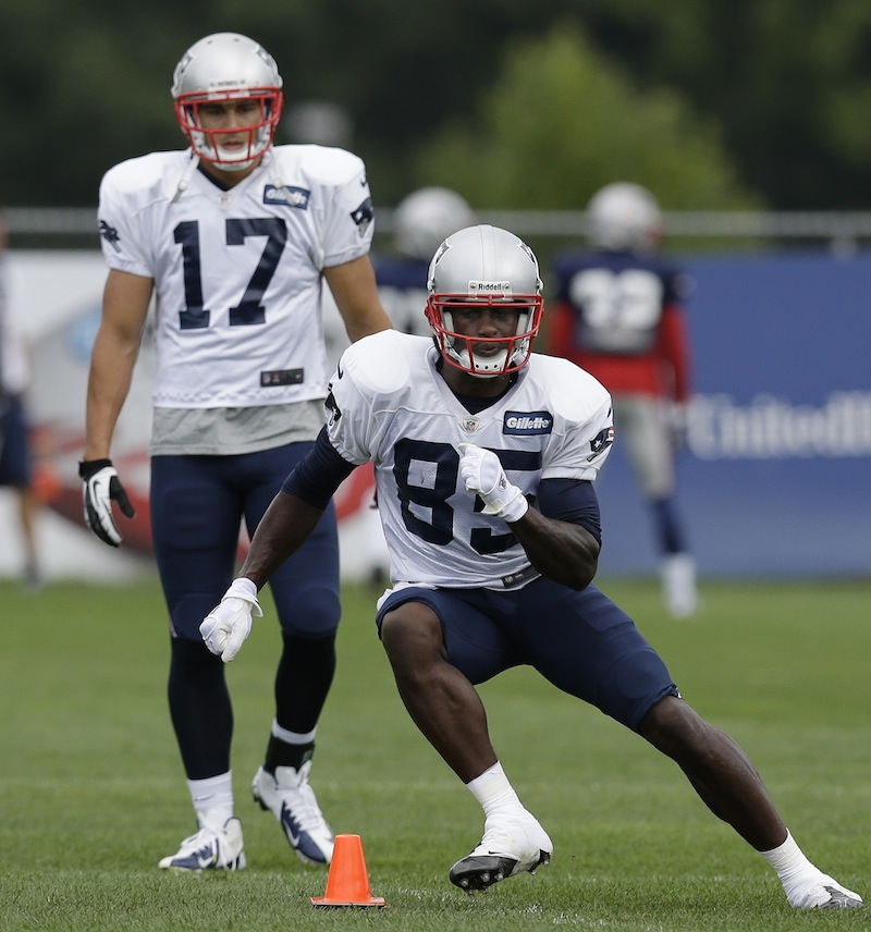 New England Patriots wide receiver Brandon Lloyd (85) cuts as wide receiver Greg Salas (17) watches during a practice drill at Gillette Stadium in Foxborough, Mass. Wednesday, Sept. 5, 2012. The Patriots are preparing for their NFL football season opener against the Tennessee Titans on Sunday. (AP Photo/Elise Amendola)