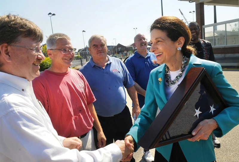 "Maine Senator, Olympia Snowe, says good-bye to Portsmouth Naval Shipyard workers from left, Mark Nelson, Paul O'Connor, Arvard Worster, Mike Melhorne and Jeffery Phillips, after a ceremony held in Kittery, Maine, Friday, Sept. 14, 2012. Snowe told shipyard workers that she'll never forget what they have done for the nation's defense and called them ""simply the best."" Snowe also expressed confidence that the fire-damaged USS Miami will be restored by shipyard workers to ""better than new."" (AP Photo/The Herald, Deb Cram)"