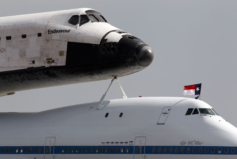 A Texas flag inadvertently flies upside down as NASA's 747 Shuttle Carrier Aircraft taxis the Space Shuttle Endeavour into position at Ellington Field in Houston on Wednesday morning September 19, 2012. Endeavour will spend the night in Houston before continuing its journey from the Kennedy Space Center in Florida to the California Science Center in Los Angeles where it will be on permanent display.