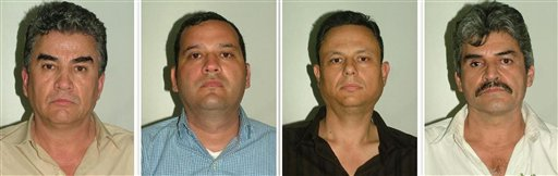 This photo released by the Spanish Interior Ministry shows suspected members of a Mexican drug cartel, from left: Jesus Gutierrez Guzman, Samuel Zazueta, Rafael Humberto Celaya Valenzuela, and Jesus Gonzalo Palazuelos Soto. Spanish police working in a joint investigation with the FBI's Boston Division have halted an attempt by a major Mexican drug smuggling ring to establish a European operation. Investigators intercepted a container carrying 822 pounds of cocaine in July, leading to the arrests.