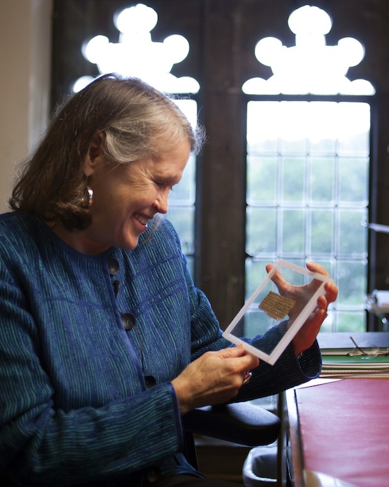 Divinity professor Karen L. King holds a 4th-century fragment of papyrus that she says quotes Jesus explicitly referring to having a wife. King, an expert in the history of Christianity, says the text contains a dialogue in which Jesus refers to
