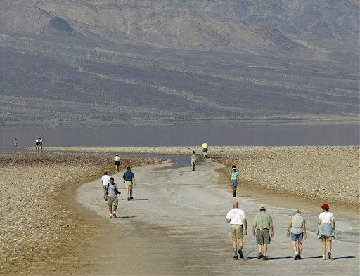 Tourists walk down to the edge of the Badwater Basin, the lowest elevation in the United States, 282 feet below sea level, at Death Valley National Park, Calif. Death Valley is now deemed the world's hottest place.